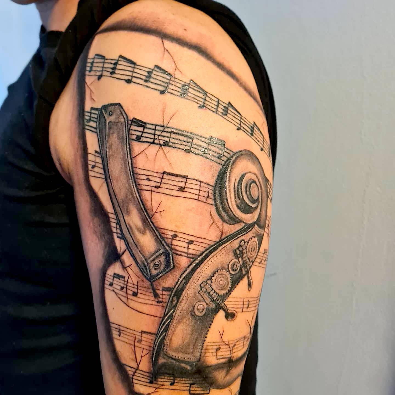 attoo Anansi München studio Vedran symbol music sleeve black and white